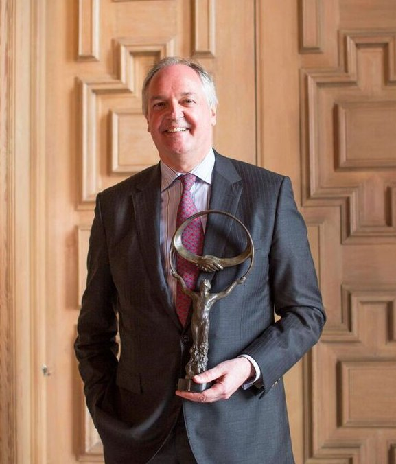 Paul Polman with statue